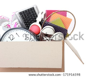 Cardboard box full of stuff ready for Moving Day isolated on white background - stock photo