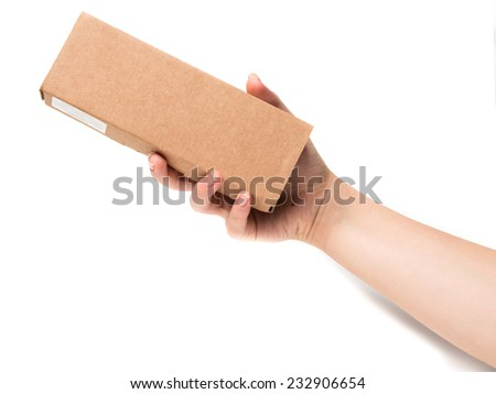 Cardboard box in hand isolated on white - stock photo