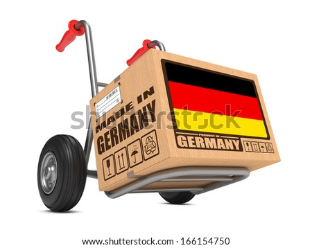 Cardboard Box with Flag of Germany and Made in Germany Slogan on Hand Truck White Background. Free Shipping Concept. - stock photo
