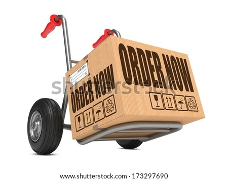 Cardboard Box with Order Now on Hand Truck White Background. - stock photo