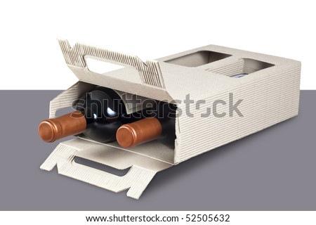 Cardboard box with wine bottles in it - stock photo