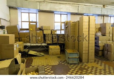 Cardboard boxes in a warehouse - stock photo