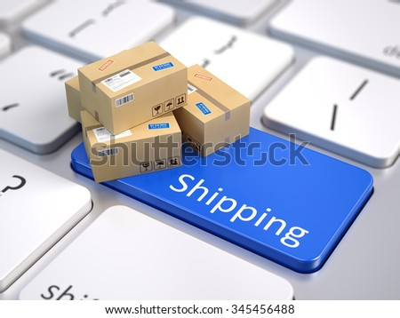 Cardboard boxes on computer keyboard - Shipping concept  - stock photo