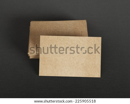 Cardboard business cards on textile background - stock photo