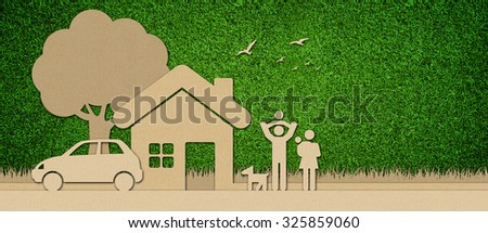 Cardboard cut out on grass. - stock photo