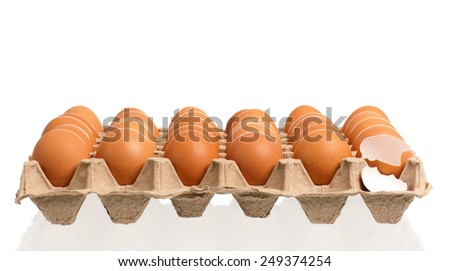 Cardboard egg box with brown eggs, isolated with clipping path  - stock photo