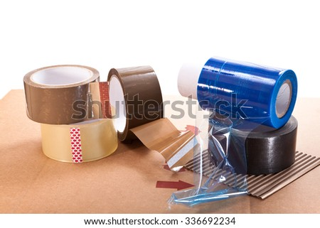 Cardboard for packaging, adhesive tape and nylon on a white background - stock photo