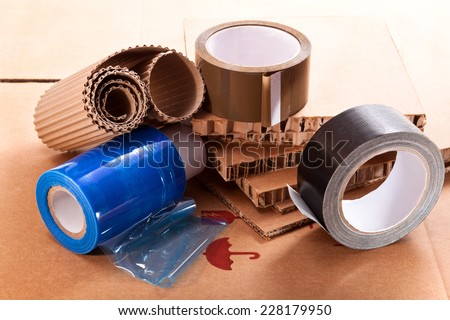 Cardboard for the packaging of different thickness, duct tape and nylon - stock photo