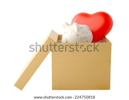Cardboard gift boxes on red hearts and piggy bank isolated on white background. This has clipping path. - stock photo