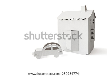 Cardboard house and automobile symbol on the white background - stock photo