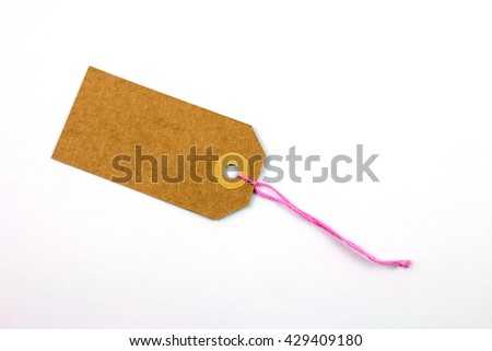 Cardboard Label with Pink Thread Isolated. - stock photo