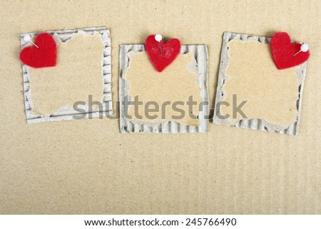 cardboard plaques and felt hearts - Valentine background - stock photo