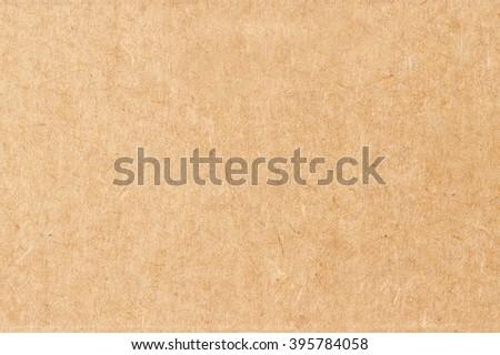 Cardboard sheet of paper. Kraft paper background  - stock photo
