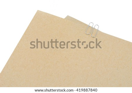 Cardboard sheet of papers,ruler and Paper Clip on white background