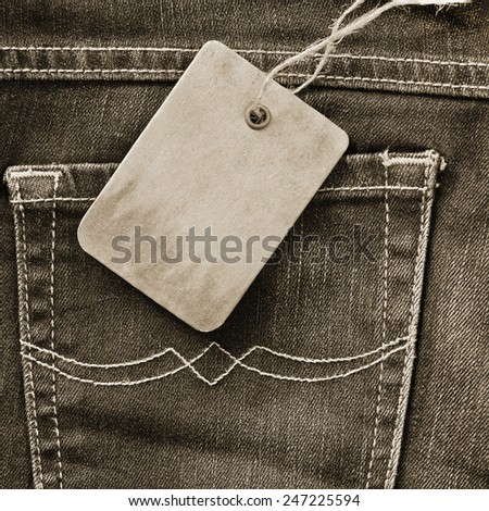 Cardboard tag on jeans - stock photo