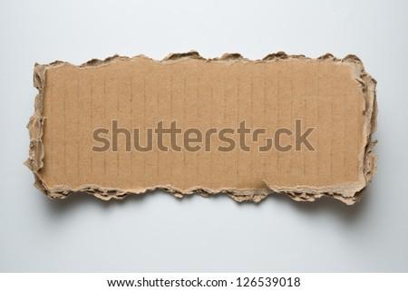 cardboard torn piece - stock photo