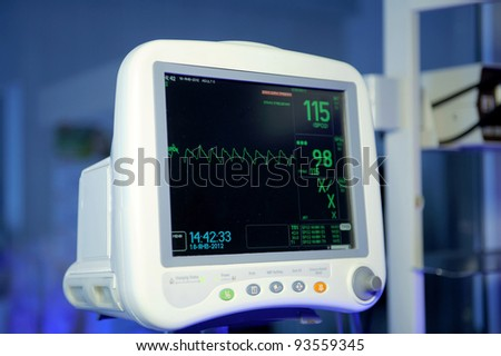 Cardiac monitor in blue light at maternity clinic - stock photo