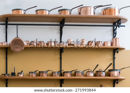 CARDIFF/UK - APRIL 19 : Shelves Full with Copper Saucepans in the Castle Kitchen at St Fagans National History Museum in Cardiff on April 19, 2015 - stock photo