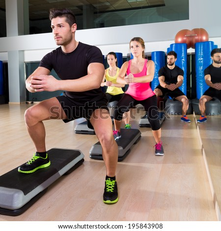 Cardio step dance squat people group at fitness gym training workout - stock photo