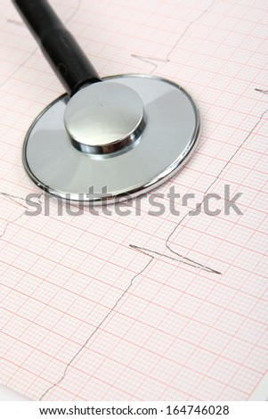 Cardiogram and stethoscope, concept for cardiovascular medical exam - stock photo