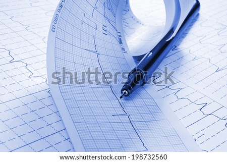 cardiogram and technical pen - stock photo