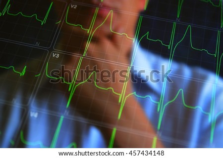 Cardiogram concept image. Healthcare, medical concept background. A man look at heartbeat cardiogram. ECG Heart beat monitor.  - stock photo