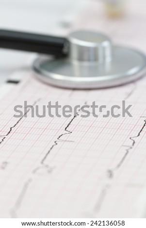 Cardiogram with stethoscope - stock photo