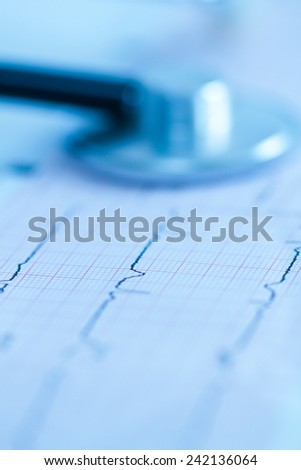 Cardiogram with stethoscope shoot with short focus - stock photo