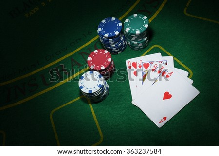 Cards and chips for poker on green table, top view. - stock photo