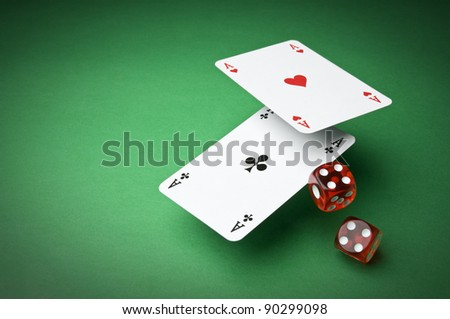 Cards and dices on green background close up - stock photo