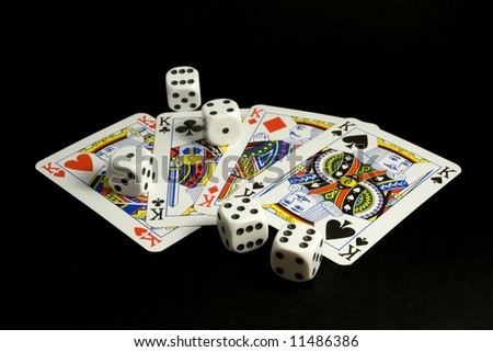 Cards and dices with black background - stock photo
