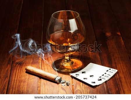 Cards, cigar and glass of whisky - stock photo
