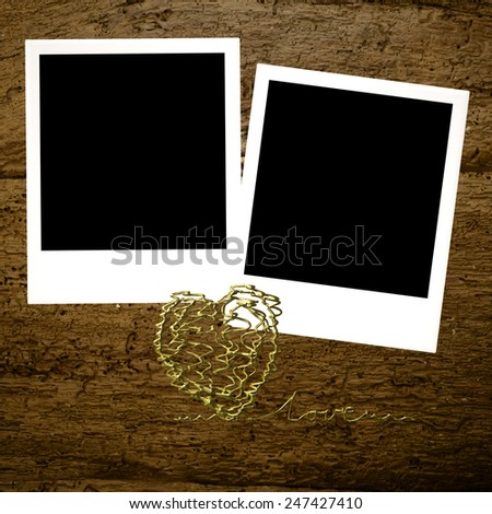 Cards for Valentine's Day or wedding,two instant photo frames and golden heart  on old wooden  background - stock photo