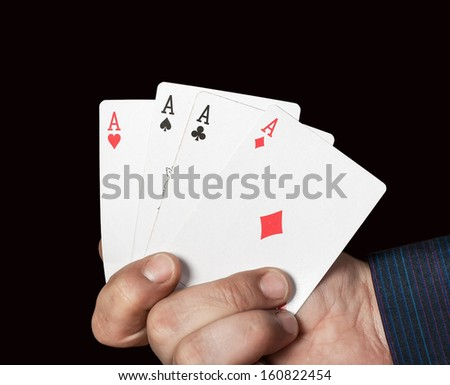 cards in the hand of lucky gambler