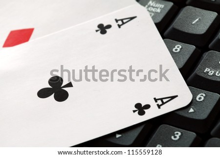 Cards over computer  keyboard. Concept of online card games. - stock photo