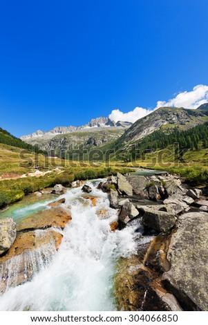 Care Alto - Adamello Trento Italy / Peak of Care Alto (3462 m) and Chiese river in the National Park of Adamello Brenta seen from the Val di Fumo. Trentino Alto Adige, Italy - stock photo