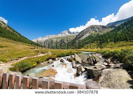 Care Alto and Chiese River - Italy / Peak of Care Alto (3462 m) and Chiese River in the National Park of Adamello Brenta seen from the Val di Fumo. Trentino Alto Adige, Italy - stock photo