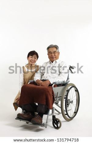 Care for elderly people and women in wheelchairs - stock photo
