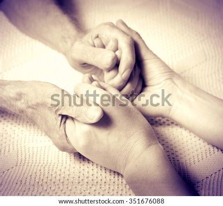 Care is at home of elderly. Senior man, with their caregiver at home. Concept of health caring for elderly old people, disabled. Elderly man. Sepia photo - stock photo
