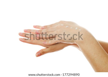 Care of female hands on white background..