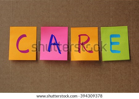 care text on colorful sticky notes - stock photo