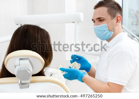 Care tips for his client. Portrait of a mature male dentist consulting his female patient during an appointment