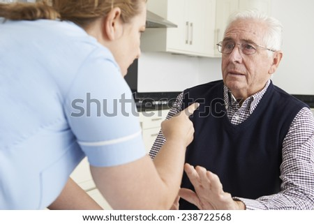 Care Worker Mistreating Elderly Man - stock photo