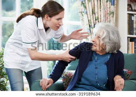 Care Worker Mistreating Senior Woman At Home - stock photo