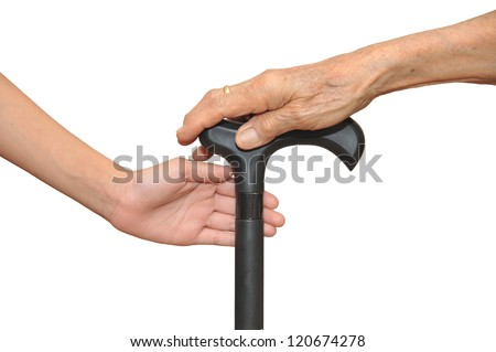 Care, Young Hand Helping Elder Holding Onto A Walking Stick - stock photo