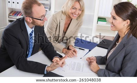 Career and candidate: three people sitting in a job interview for a management position. - stock photo