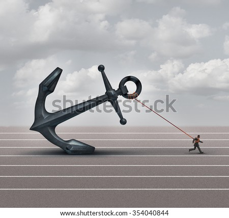 Career burden and business stress concept as a businessman or worker pulling a giant heavy metal anchor as a metaphor for hardship and struggle with taxes or oppression. - stock photo