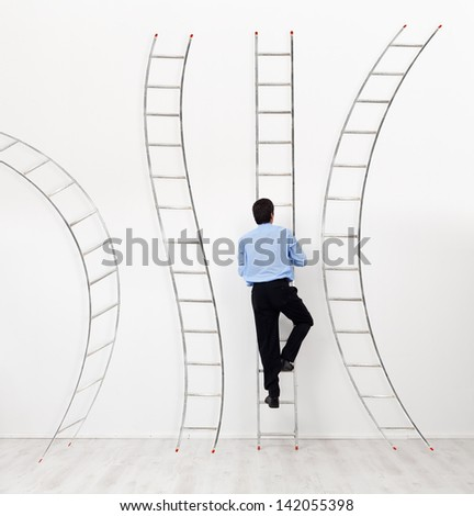 Career choices and opportunities concept - businessman climbing the right ladder - stock photo