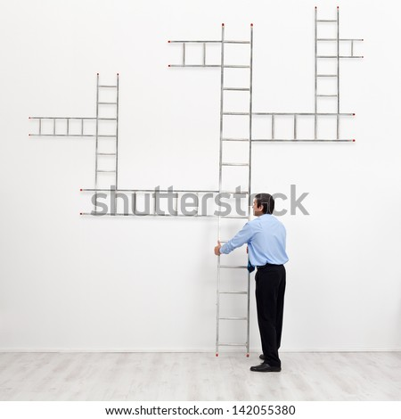 Career choices and opportunities concept - businessman with branched ladder - stock photo
