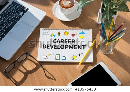 CAREER DEVELOPMENT open book on table and coffee Business - stock photo